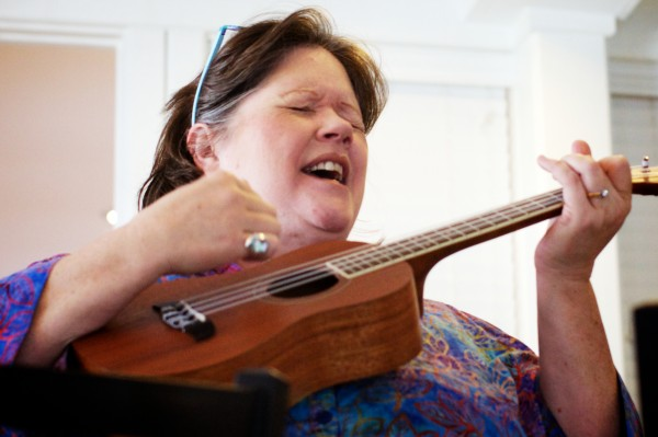 Faith York, founder and leader of the Peaks Island Ukulele Group, or PIUKE, performs at a senior luncheon on the island with a small version of the 30-plus member ensemble.