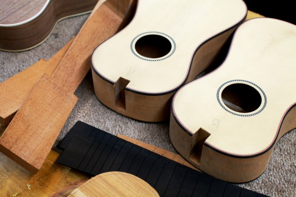 Ukulele parts sit on a workbench at Earnest Instruments in South Portland. Luthier Joel Eckhaus is a nationally known ukulele teacher and maker. He studied with famed vaudeville star Roy Smeck, who is known as the &quotwizard of the strings.&quot