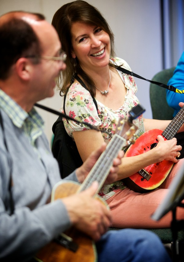 Terry Smith and Elizabeth Watson share a laugh while playing with the Falmouth Library Ukulele Ensemble, better known as the FLUKES, on a recent Wednesday night. The group meets once a week and is getting ready for a performance on June 22 at the Falmouth Historical Society.