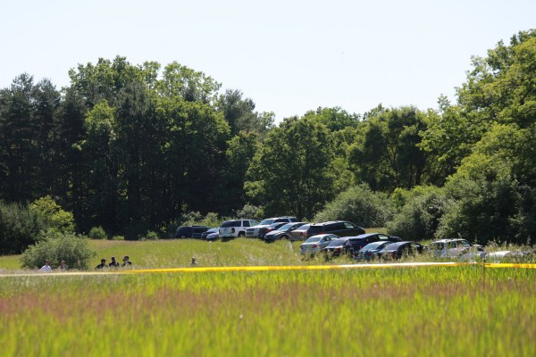 FBI, state and local authorities search for Jimmy Hoffa's body in a field in Oakland Township, Michigan, Monday, June 17, 2013.