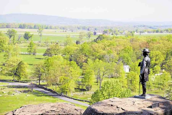 The statue of Union Gen. Gouverneur K. Warren stands on Little Round Top and overlooks Gettysburg National Military Park in Pennsylvania. Maine regiments fought within sight of where the statue stands today.