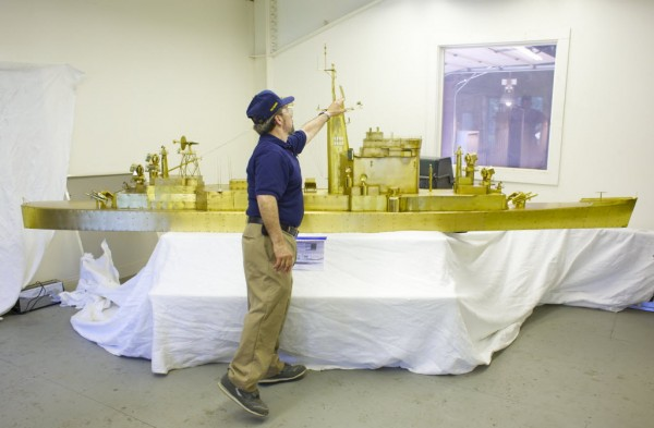 Bart Hutchins with the help of Metal Magic, a metal fabrication shop in Trenton, has restored a 14-foot long brass boat model formerly used by the US NAVY to test antenna arrays on warships.