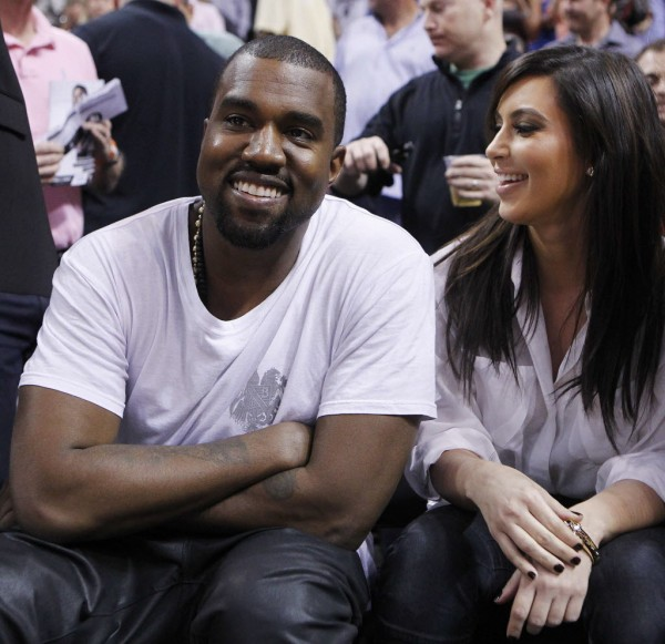 Rap musician Kanye West is seen court side with reality television star Kim Kardashian as the Miami Heat play the New York Knicks in their NBA basketball game in Miami, Florida December 6, 2012.