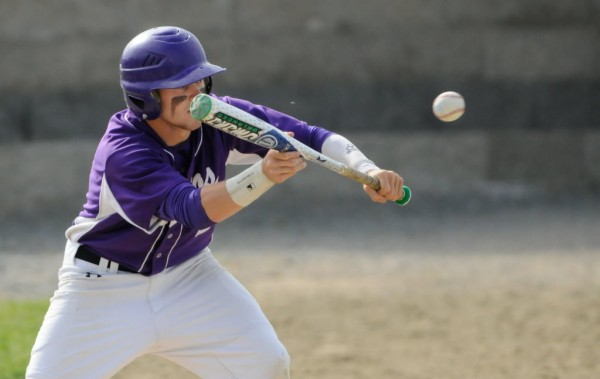 Hampden Academy's Nicholas Rodgerson attempts a bunt against Lewiston on Thursday, June 6, 2013.