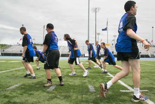 Runners warm up before the 4x100 meter relay race at the Special Olympics Maine State Summer Games at the University of Maine in Orono on Friday, June 6, 2013.