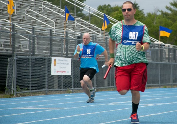 Runners sprint the last 100 meters of the 4x100 meter relay race at the l Special Olympics Maine State Summer Games at the University of Maine in Orono on Friday, June 6, 2013.