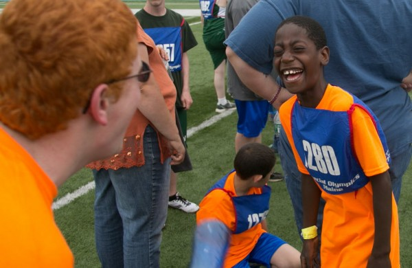 Sam Tierneu (right) of Newport laughs with a teammate before their 4x100 meter relay race at the Special Olympics Maine State Summer Games at the University of Maine in Orono on Friday, June 6, 2013.