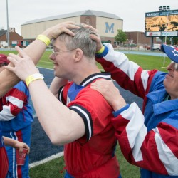 Adam Thorton (center) of Gardiner is swarmed by his teammates after finishing his 400 meter race at the Special Olympics Maine State Summer Games at the University of Maine in Orono on Friday, June 6, 2013. Over 1500 athletes from across the state competed in the Games.