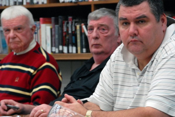 Millinocket School Committee members [left to right] Arnold Hopkins, Warren Steward and Chairman Kevin Gregory listen to Superintendent Kenneth Smith during a school board meeting at Stearns High School on Tuesday, Feb. 5, 2013.