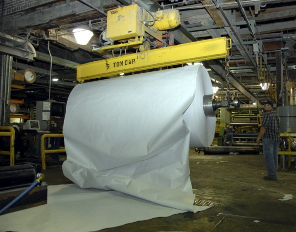 A large roll of freshly-made paper gets pulled from a papermaking machine at Lincoln Paper and Tissue LLC in this file photo from 2011.