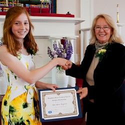 Yvonne Rogers, Adams School in Castine receives newly established Student Membership Award from Martina Herries, Executive Director, Bagaduce Music Lending Library, Blue Hill, Maine.  (Photo by Rosemary Wyman)