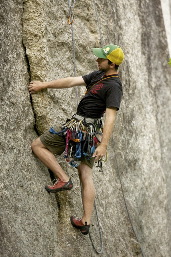 Jared Garfield, Manager of Rental Equipment and Repairs at the Mainebound Adventure Center, climbs the 5.9 route &quotWheaties&quot at Eagle Bluff in Clifton, Maine.