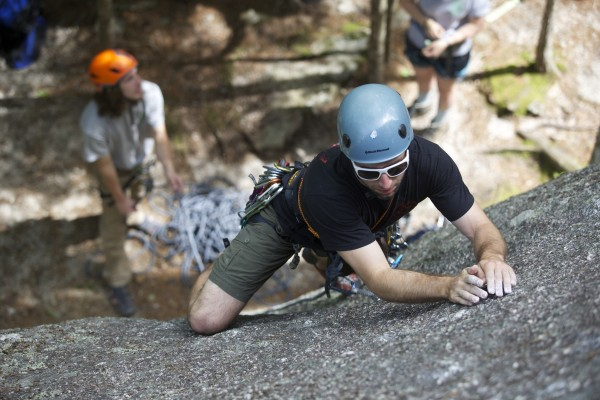 Jared Garfield, Manager of Rental Equipment and Repairs at the Mainebound Adventure Center, climbs the 5.7+ route Highlander at Eagle Bluff in Clifton, Maine.