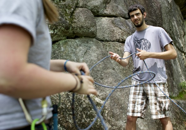From left, Hilary Buntrock and John Vicenzi flake a rope before climbing at Eagle Bluff in Clifton, Maine.