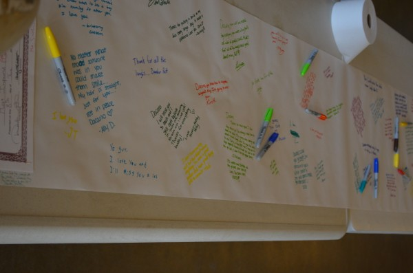 Students wrote on a banner dedicated to Dacano Arno in a hallway at Foxcroft Academy in Dover-Foxcroft on June 4, 2013.