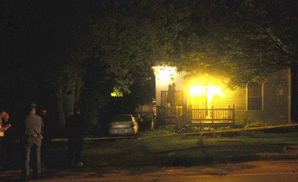 Crime scene tape surrounds a house on Main Road South in Hampden on Sunday night after a man was fatally shot by a police officer.