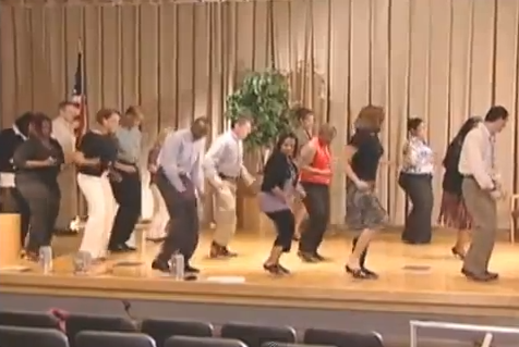 IRS employees learn to dance the Cupid Shuffle.