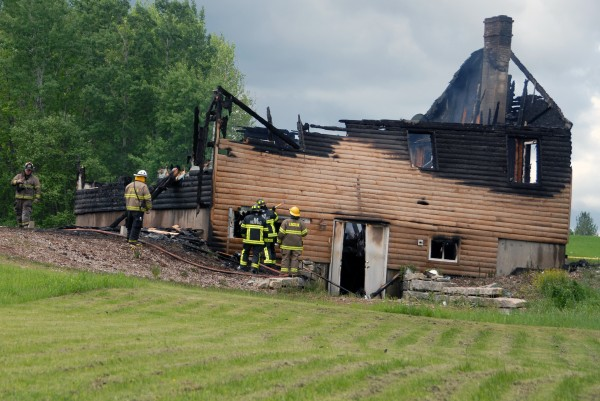 A log cabin home at 391 Phillips Road in Winn was destroyed by fire on Tuesday, June 4, 2013.