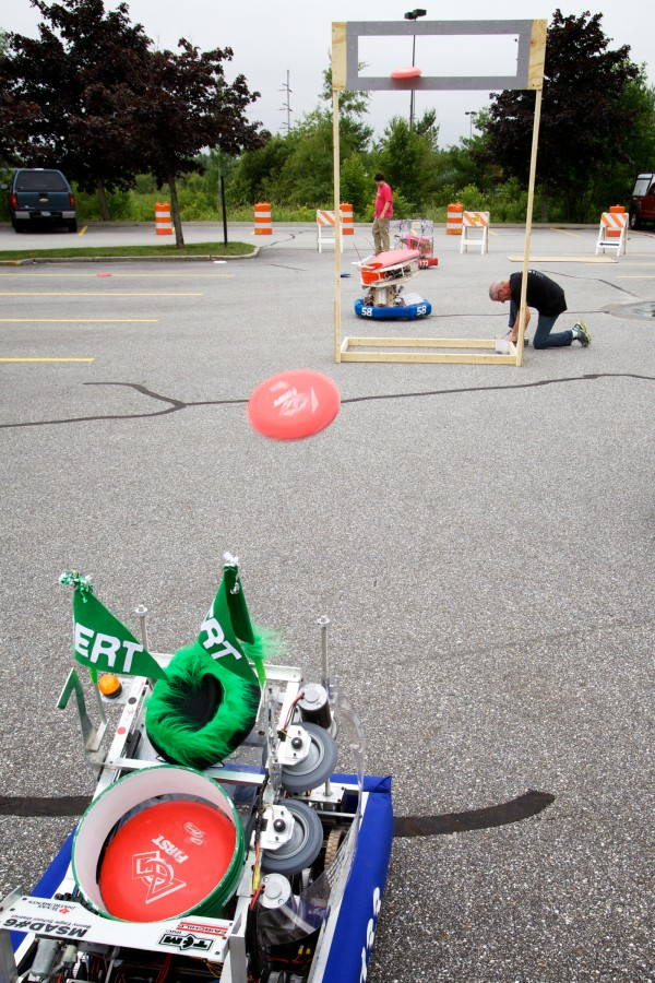 A robot hurls discs at at target in the parking lot at Fairchild Semiconductor in South Portland Thursday as part of the launch of the Robotics Institute of Maine.