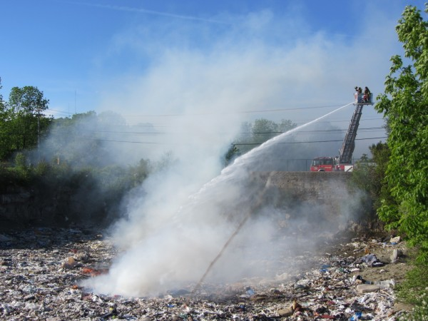 A Rockland fire department truck pours water on a fire at the Rockland dump on Wednesday afternoon.