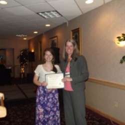Kathryn Asalone accepts the Dennis Johnston Maine Innkeepers Association Education Foundation scholarship from Jeanne Carpentier of Emerald Hospitality Associates.