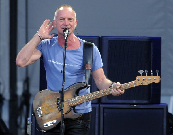 Sting listens for the audience to repeat a line back to him during his performance of &quotEvery Little Thing She Does Is Magic&quot during his Back to Bass tour at the Darling's Waterfront Pavilion on Thursday.