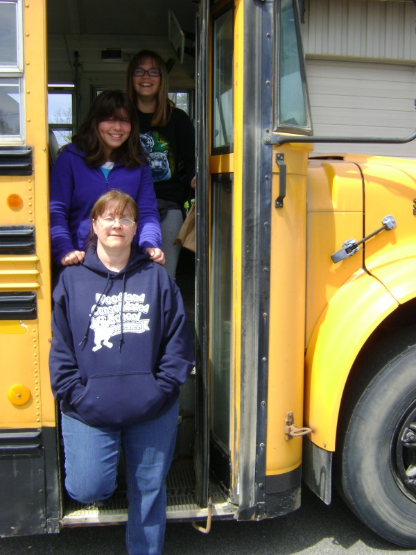 Sixth-graders Zoey Jones (top) and Hollie McDougal were among students from Woodland Consolidated School in Aroostook County who recently toured Cole Land Transportation Museum in Bangor with teacher Sandra Swan, who also drove the bus for the three-hour trip. Cole Museum Photo
