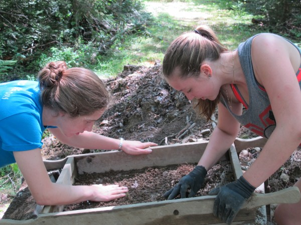 Megan Postemski, left, of Lebanon, Conn., and Erin Moyer, right, of Hopatcong, N.J., sift through the dirt looking for small 17th-century artifacts from the Joy/Flood excavation site in Surry, Maine.