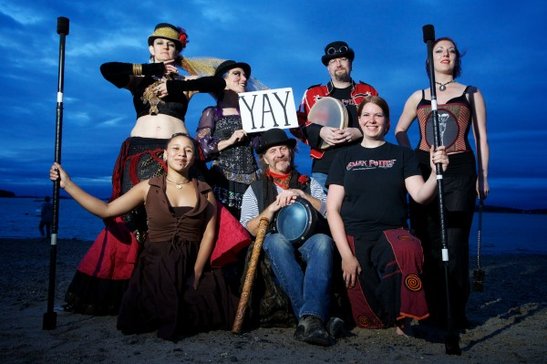 Performers and musicians from Dark Follies (from left) Joie Grandbois, Rosa Libby, Bet Black, Stephen Carpenter, Kevin Reams, Brigid Sinclair Rankowski and Janice Pratt, pose for a photo on Portland's East End Beach.