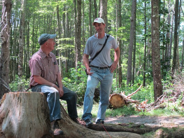 Professor Ben Carter, right, chats with Stanley Richmond, who owns the land where the Joy/Flood site was found, and has family connections to the earliest settlers in the Surry region.