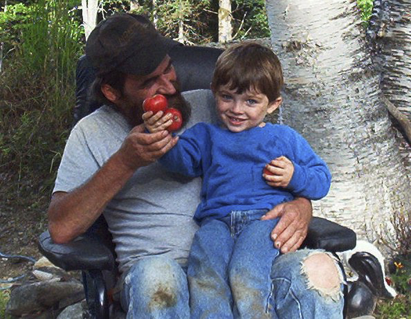 Jeffrey Ryan (left) holds son Jesse Ryan at their home in Amity in an undated photo. Their bodies along with that of family friend Jason Dehan, were found June 23, 2010,  at Jeffrey Ryan's U.S. Route 1 mobile home. All three had been stabbed to death, allegedly by Thayne Ormsby, who was living in Orient at the time of the killings. Ormsby has pleaded not guilty to all charges against him.