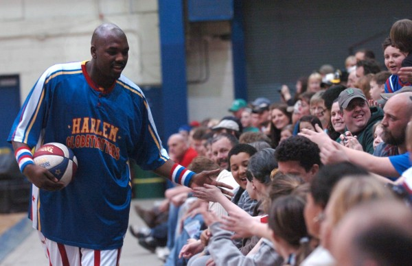 Nate &quotBig Easy&quot Lofton of the Harlem Globetrotters meets fans before their game against the Washington Generals at the former Bangor Auditorium.