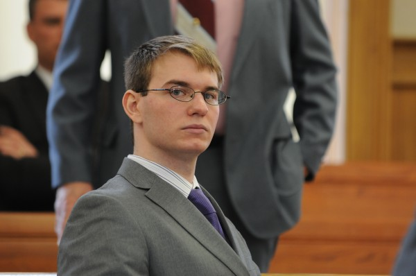 Thayne Ormsbyturns during his triple homicide trial in superior court in Houlton on Monday, April 9, 2012.