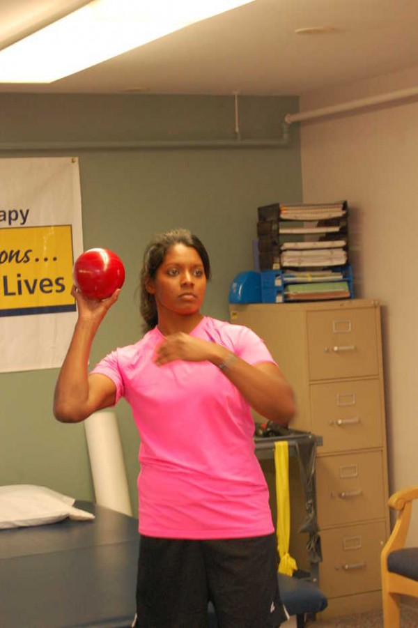 Wounded Army military policewoman Sgt. Helaina Lake prepares to throw a weighted ball during occupational therapy at the Stanley Health Center in Farmington. Lake was seriously injured in a suicide-bombing in Afghanistan on June 20, 2012.