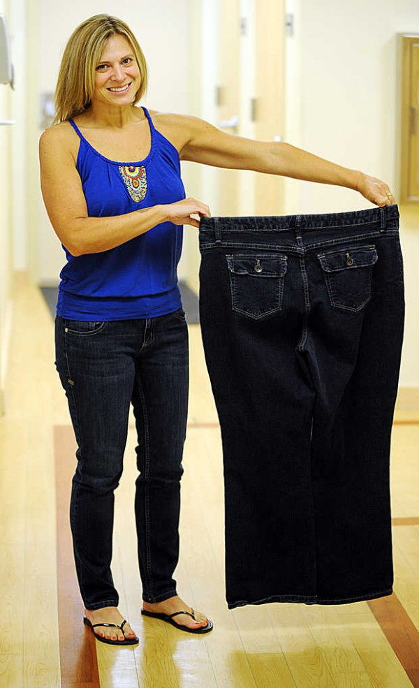 Susan Dutil holds up the jeans she used to wear before a surgery from Central Maine Bariatric Surgery in 2011. Dutil shed 100 pounds and kept it off by changing habits and eating small portions.