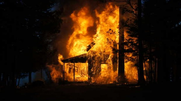 A camp on Sandy Shore Lane in Norway burns Wednesday night.