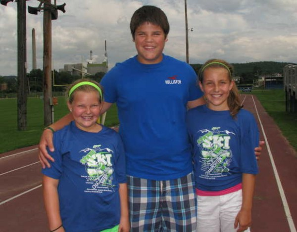 Hoping to save their beloved downhill ski area, Black Mountain of Maine in Rumford, 14-year-old Curtis Gauvin of Rumford, flanked at left by Avery Sevigny, 11, and at right by her sister Rylee Sevigny, 10, both of Mexico, organized a 5-kilometer fun run for Aug. 10 that starts and ends at the Hosmer Field track on which they're standing. All proceeds from the race they've dubbed the &quotHit the Track for Black 5K&quot will go to Black Mountain.