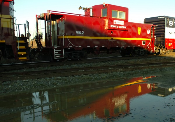 Montreal, Maine & Atlantic's remote control for locomotives is a converted caboose, outfitted with computer-controlled pneumatics. It can be coupled with any locomotive to make it remote-controllable.
