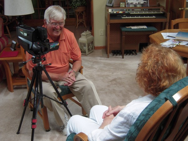 Dr. Marc Chasse interviews former photographer Philomena Baker of Bangor during her recent visit to Fort Kent, adding to his collection of more than 500 two-hour video tapes documenting the people and events of the St. John Valley.