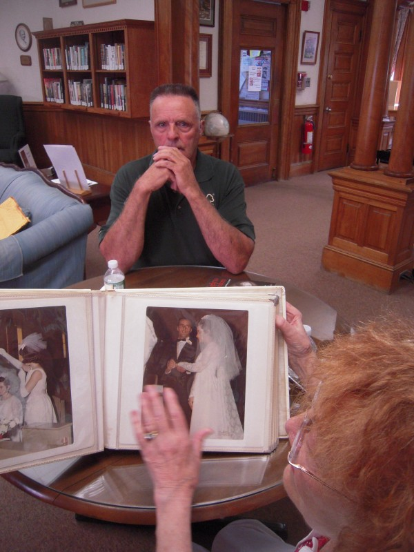 Maynard Thibodeau of Caribou came to the Caribou Library on June 25 to show Philomena Baker the album of wedding photos she took 45 years ago when he was married in Caribou.