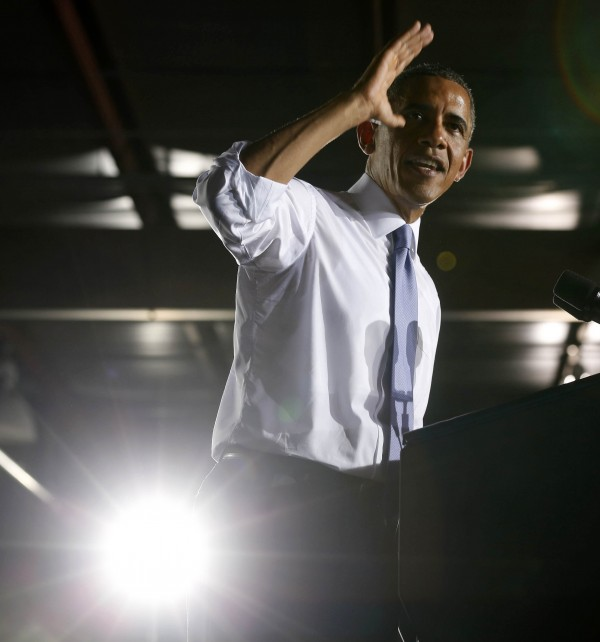 U.S. President Barack Obama gestures while he speaks about the U.S. economy inside the main warehouse at the Jacksonville Port in Florida, July 25, 2013.