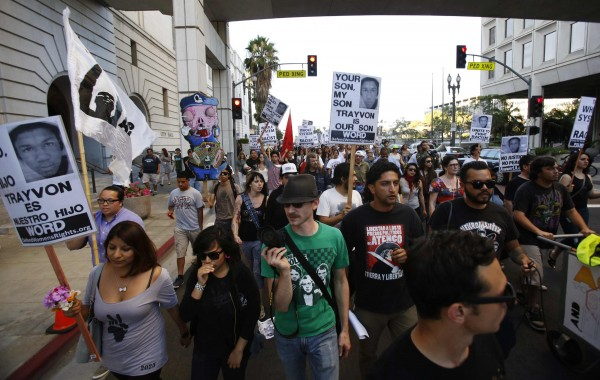 People march during a rally organized by the Act Now to Stop War and End Racism (ANSWER) coalition to protest the acquittal of George Zimmerman for the shooting death of Florida teenager Trayvon Martin, in Los Angeles, California July 16, 2013.