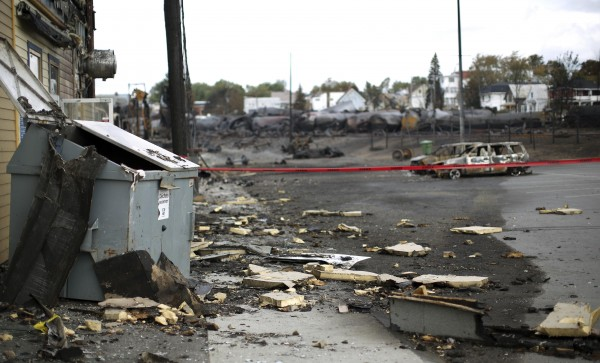 Debris from the explosion of a train are seen in Lac Megantic, July 9, 2013. Several people were missing after four tank cars of petroleum products exploded in the middle of a small town in the Canadian province of Quebec early on Saturday in a fiery blast that destroyed dozens of buildings.