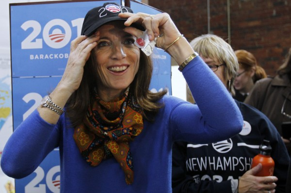 Caroline Kennedy puts on an Obama 2012 hat given to her by a volunteer for U.S. President Barack Obama at the Obama for America New Hampshire Office in Portsmouth, New Hampshire on November 3, 2012.