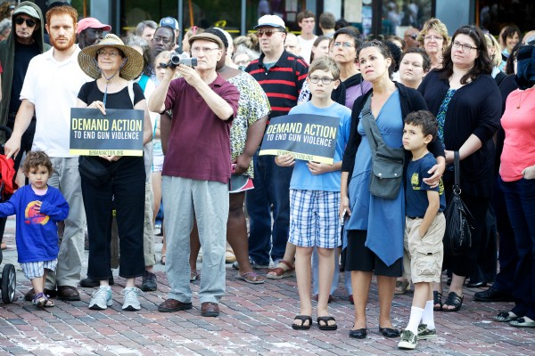 About 200 people listen to speakers in Portland's Monument Square Monday afternoon during a memorial service and rally for Trayvon Martin.