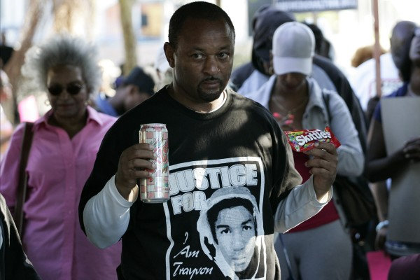 Community activist Najee Ali holds Skittles and an ice tea during a peaceful protest of the acquittal of George Zimmerman for the 2012 shooting death of Trayvon Martin, in Los Angeles, California July 15, 2013.