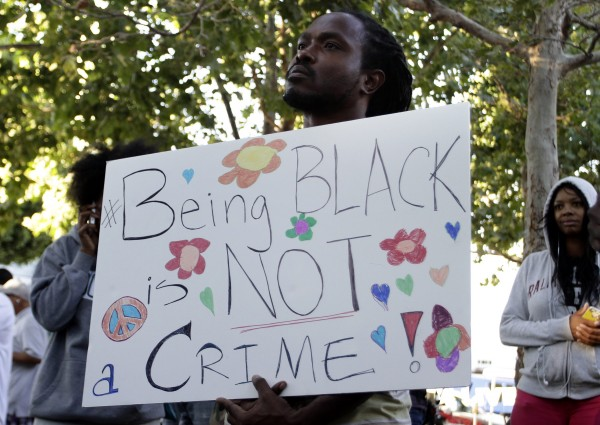 A man holds a sign at Leimert Park during a peaceful protest of the acquittal of George Zimmerman for the 2012 shooting death of Trayvon Martin, in Los Angeles, California July 15, 2013.