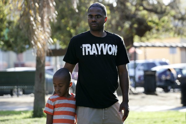Jovan Blacknell (R) and his son Justice attend a peaceful protest of the acquittal of George Zimmerman for the 2012 shooting death of Trayvon Martin, in Los Angeles, California July 15, 2013.