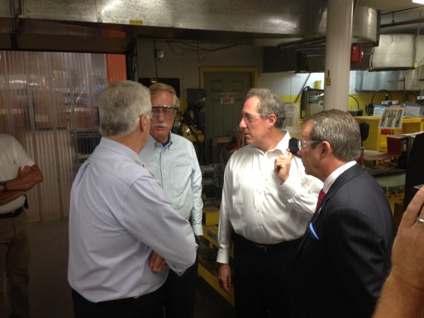 U.S. Rep. Mike Michaud, Sen. Angus King, U.S. Trade Representative Michael Froman and New Balance CEO Rob DeMartini talk about trade issues Monday at the New Balance factory in Norridgewock.