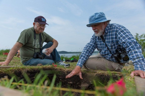 University of Maine Associate Professor of Anthropology Brian Robinson (right)and Donald Soctomah, historic preservation officer for the Passamaquoddy Tribe, examine one of the dig sites at Long Point in Machiasport that Robinson and his crew have been excavating this spring.